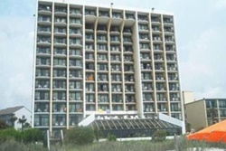 large, 12 story apartment building on the beach with a full front of all balconies, pet friendly vacation rental in myrtle beach