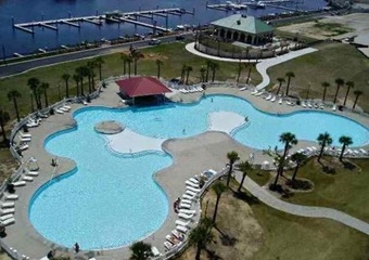 aerial photo of pool with marina and dock, lounge chairs all around pool and tiki bar, myrtle beach pet friendly vacation rental home