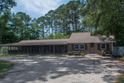 exterior one story building sit and stay awhile pet care center, doggy daycare in myrtle beach